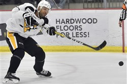 Trevor Daley goes through drills during training camp Sept. 23 at the UPMC Lemieux Sports Complex in Cranberry.