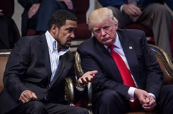 Donald Trump, the Republican presidential nominee, speaks with Pastor Darrell Scott  during the the Midwest Vision and Values Pastors and Leadership Conference in Cleveland Heights, Ohio, Wednesday.