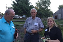 Barn Party: Tom Succop, left, with Doug and Shelly Campbell.