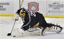 Penguins goaltender Marc-Andre Fleury makes a save during training camp Friday at UPMC Lemieux Sports Complex in Cranberry.