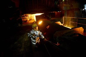 A Tata Steel worker checks the temperature of the one of the plant's blast furnaces.
