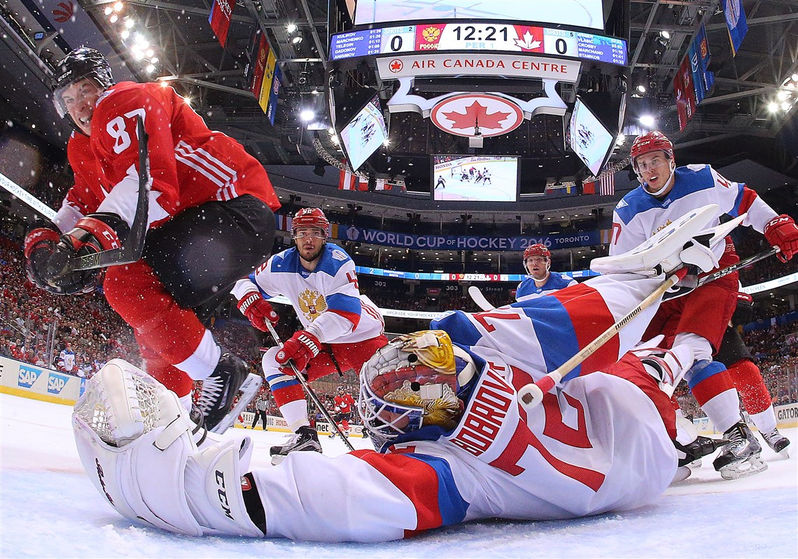 Crosby leads canada past russia in world cup semifinal pittsburgh sidney crosby of team canada scores a first period goal past a diving sergei bobrovsky of gumiabroncs Image collections