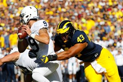 Chris Wormley of the Michigan Wolverines sacks quarterback Trace McSorley of the Penn State Nittany Lions during the first quarter of Saturday's game at Michigan Stadium.
