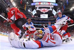 Sidney Crosby of Team Canada scores a first period goal past a diving Sergei Bobrovsky of Team Russia in the semifinal game during the World Cup of Hockey tournament at Air Canada Centre Saturday in Toronto.