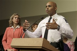 Charlotte-Mecklenburg Police chief Kerr Putney, right, gestures Friday as Charlotte mayor Jennifer Roberts, left, watches in Charlotte, N.C. during a news conference concerning protests and the investigation into Tuesday's fatal police shooting of Keith Lamont Scott.