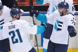 Team Europe forward Tomas Tatar, left, celebrates with teammate Pierre-Edouard Bellemare after scoring the winning overtime goal Sunday against Team Sweden in the World Cup of Hockey semifinal in Toronto.