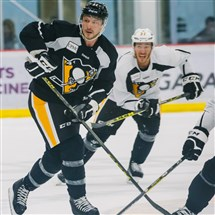 Kevin Porter and Carter Rowney skate during workouts Monday at the UPMC Lemieux Sports Complex.