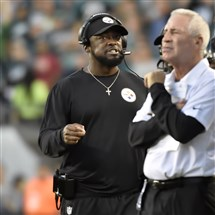 Mike Tomlin talks on his headset after the Eagles scored against the Steelers in the first quarter of Sunday's game at Lincoln Financial Field in Philadelphia.