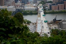 Cars pass over the Liberty Bridge on Monday evening after it reopened to vehicles weighing under nine tons.