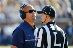 Penn State coach James Franklin talks with an official after a targeting call was made on linebacker Brandon Smith during last season's game at Michigan.