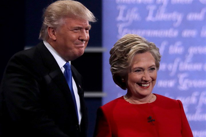 Hillary Clinton And Donald Trump Face Off In First Presidential Debate At Hofstra University-1 Democratic presidential nominee Hillary Clinton takes the stage with Republican presidential nominee Donald Trump during the first presidential debate at Hofstra University on September 26, 2016 in Hempstead, New York.