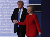 Republican U.S. presidential nominee Donald Trump shakes hands with Democratic U.S. presidential nominee Hillary Clinton at the conclusion of their first presidential debate at Hofstra University on Long Island Monday night.