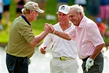 This May 5, 2012, file photo shows Jack Nicklaus, left, Gary Player, center, and Arnold Palmer reacting after Palmer's birdie putt on the 18th green during a Greats of Golf event in The Woodlands, Texas.