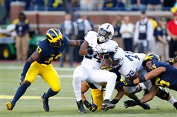 Penn State's Miles Sanders tries to gain a few extra yards against the Michigan defense in 2018.