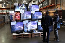 Costco customers look at a display of LCD HDTV televisions in 2009 in San Francisco, California. A new study from the Natural Resources Defense Council claims flaws in federal energy tests on televisions have allowed large manufacturers to significantly understate their devices' power consumption.
