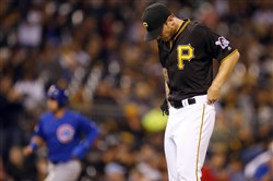 Chad Kuhl reacts after giving up a grand slam in the fourth inning against the Cubs on Monday.