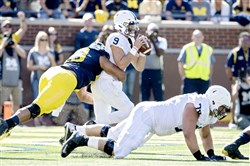 Penn State quarterback Trace McSorley gets sacked by Michigan defensive end Chris Wormley Saturday in Ann Arbor, Mich.