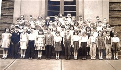 First-grade students who began school at Sacred Heart Elementary School in Shadyside in 1952 pose for a class photo. A group of classmates from this and another first-grade classroom today will celebrate their turning 70.