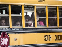 A Townville Elementary student looks out of the window of a school bus as she and her classmates are transported to Oakdale Baptist Church, following a shooting at the school.