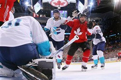 Canada's Patrice Bergeron celebrates his third-period goal Tuesday against Europe.
