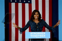 First lady Michelle Obama campaigns Wednesday on behalf of Democratic presidential candidate Hillary Clinton at the Fitzgerald Field House on the University of Pittsburgh campus in Oakland.