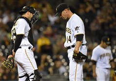 Pirates catcher Francisco Cervelli talks with starter Ryan Vogelsong after giving up a three run triple to the Cubs in the second inning at PNC Park on Tuesday.