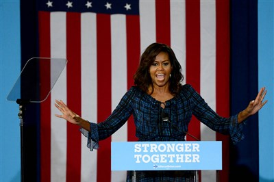 In stumping for Clinton, first lady criticizes Republican nominee