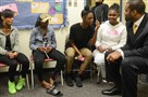 "University Prep principal Christopher Horne speaks with students during a ""Girls Circle,"" a structured group designed to encourage girls to share experiences that are helpful to one another in September."