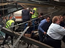 Passengers rush to safety after a NJ Transit train crashed into the platform at the Hoboken Terminal this morning.