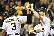 The Pirates' John Jaso is greeted at home by Sean Rodriguez after hitting a three-run homer against the Cubs at PNC Park.