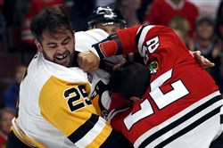 Blackhawks forward Jordin Tootoo, right, fights Penguins forward Tom Sestito during the first period of a preseason game in September.