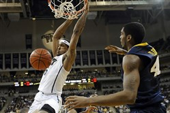 Pitt's Gilbert Brown dunks against West Virginia in a February, 2011, game.
