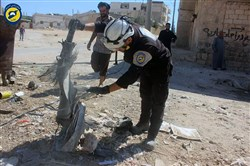 This photo provided by the Syrian Civil Defense group known as the White Helmets shows members of Civil Defense inspecting the cluster bombs in the Khan Sheikhoun neighborhood of Idlib, Syria, on Thursday.