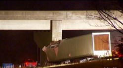 The driver of this tractor-trailer truck was killed early this morning when he veered off I-79 north and crashed into an overpass.
