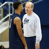 First-year coach Kevin Stallings talks with Damon Wilson during Pitt's first practice Friday at Petersen Events Center. Matt Freed/Post-Gazette
