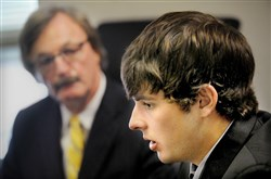 Gabriel Despres, 20, talks about his November encounter with former Pittsburgh police Sgt. Stephen Matakovich during a news conference at the Downtown office of his attorney, Tim O'Brien (background). Mr. Despres was arrested at Heinz Field in November for public drunkeness, and was pushed and hit by Mr. Matakovich, who has since been fired from the force.