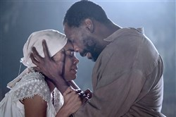 "Gabrielle Union as ""Esther"" and Colman Domingo as ""Hark"" in ""The Birth of a Nation."""