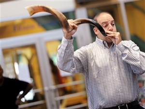 Rabbi Alex Greenbaum demonstrates the blowing of the shofar. The blowing of the shofar, or ram's horn, is the traditional way of marking the start of Rosh Hashana.