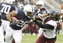 Penn State running back Saquon Barkley stiff arms Minnesota's Jalen Myrick in the first half Saturday at Beaver Stadium in State College, Pa.