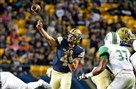 Pitt quarterback Nate Peterman gets a throw off against Marshall in the second quarter Saturday at Heinz Field.