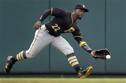 Pirates center fielder Andrew McCutchen misses a ball hit for an RBI-single by Cardinals catcher Yadier Molina Sunday.