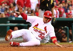 Aledmys Diaz of the St. Louis Cardinals scores a run against the Pittsburgh Pirates in the third inning at Busch Stadium on Sunday.
