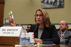 Mylan Inc. CEO Heather Bresch holds up an EpiPen 2-pack as she testifies before the House oversight committee last month on Capitol Hill.