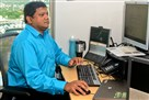 Vista Mohanty, a senior applications developers, works at his desk at Highmark, Downtown.