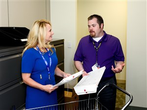 Michelle Labash, manager of administrative services for the western region for Highmark Inc., talks with Justin Hucko, a general clerk with Gateway Health Plan, in the mail center at Highmark's Fifth Avenue Place building, Downtown. Ms. Labash, who was diagnosed with dyslexia at age 6, joined Highmark in 1996.