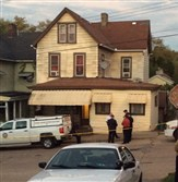 Allegheny County detectives remain outside the McKeesport house where a couple was found dead and three of their children were found unharmed Monday.