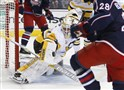 The Penguins' Tristan Jarry makes a save against the Columbus Blue Jackets in a game in Oct. 2, 2016, in Ohio.