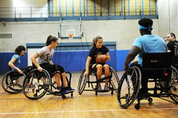 Lainey Elliott of Oakland drives the ball down the court Oct. 6 at a practice game of wheelchair basketball in Oakland.