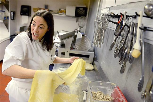 Jamie Tavelaris, executive chef of Ten Penny in Downtown, makes her handmade porcini mascarpone ravioli.