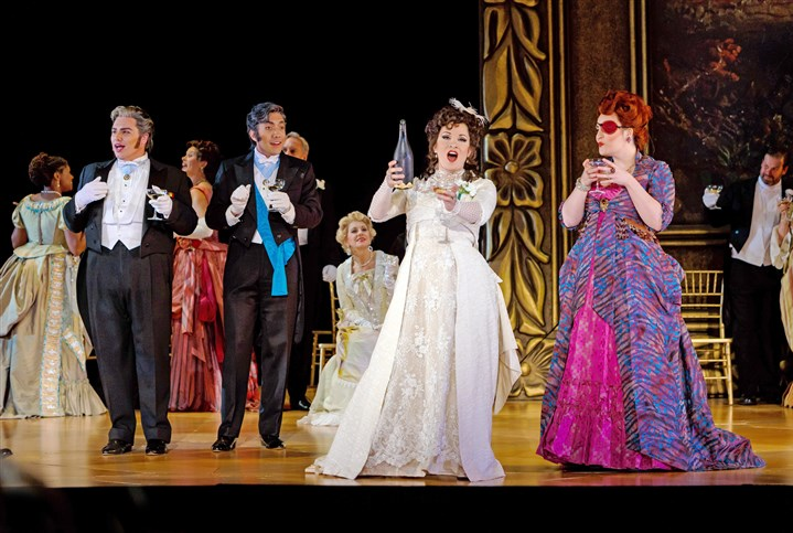 Pittsburgh Opera in 'La traviata' Courtesan Violetta Valéry (Danielle Pastin), center in white dress, raises a toast with her friends Gastone de Letorieres (Eric Ferring), from left, Marquis d'Obigny (Andy Berry) and Flora Bervoix (Leah de Gruyl).